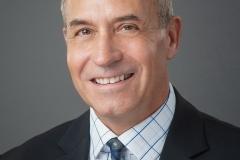 Headshot with grey background
